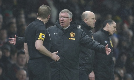 The Manchester United manager, Sir Alex Ferguson, complains to the assistant referee Jake Collin at half-time against Newcastle United.
