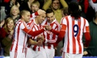 Jonathan Walters, second left, celebrates after scoring the third goal for Stoke City against Liverpool.