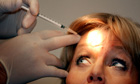 Woman receives Botox injection