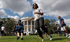 Michelle Obama runs with schoolchildren to promote exercise