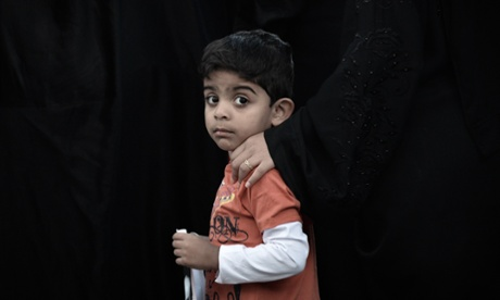 A Bahraini Shia boy takes part to a demonstration in solidarity with political prisoners in the village of Malikiya, south of Manama. Bahrain has announced a date for the trial of the thirteen Shia opposition leaders jailed for their role in last year's unrest.