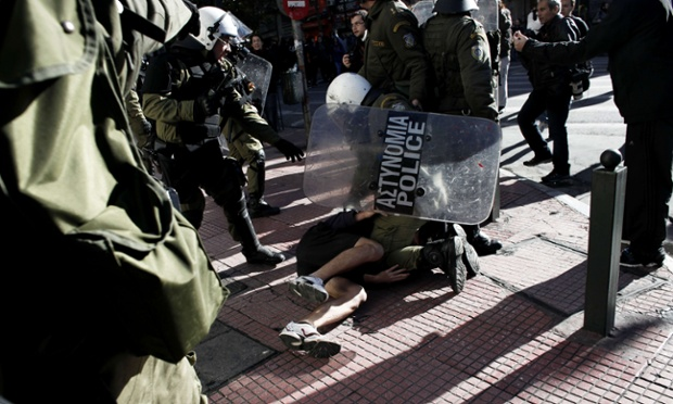 Riot police detain a protestor in Athens during a students' march in commemoration of teenager Alexis Grigoropoulos, 15, who was shot by police on December 6, 2008 sparking a series of violent riots.