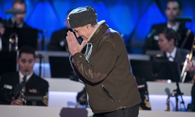 Singer James Taylor bows after singing during the 90th annual national Christmas tree lighting on the Ellipse of the National Mall. US President Barack Obama and others attended the event last night.