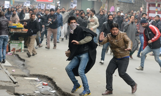 Activists from the Jammu and Kashmir Libration Front throw stones during a protest against a court verdict sentencing two Kashmiris to life imprisonment in Srinagar.