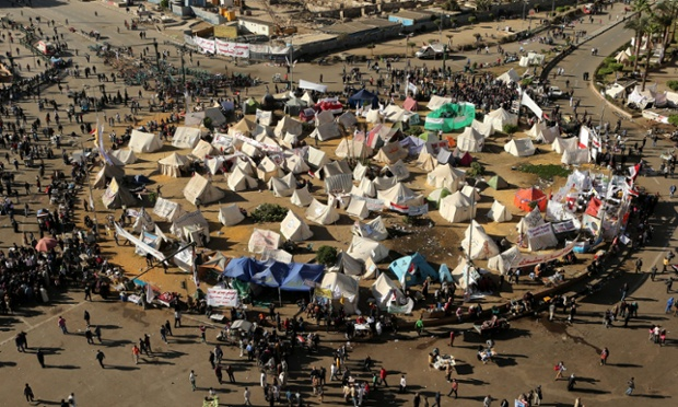 A general view shows tents and protesters during a sit-in against the President Mohamed Morsi decree in Tahrir Square, Cairo, this morning.
