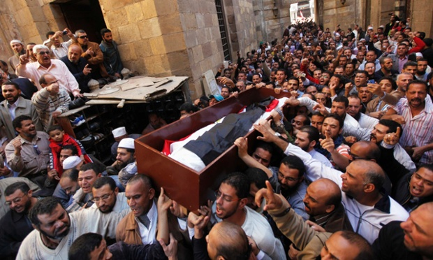 Meanwhile supporters of Egyptian President Mohamed Mursi and members of the Muslim Brotherhood carry the coffin of Mohamed Mamdouh al-Husseini, who died in recent clashes at the presidential palace.