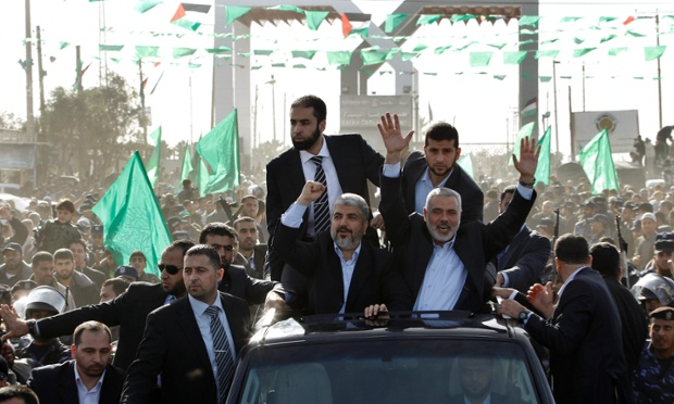 Hamas chief Khaled Meshaal, front left, riding in a car with senior Hamas leader Ismail Haniyeh