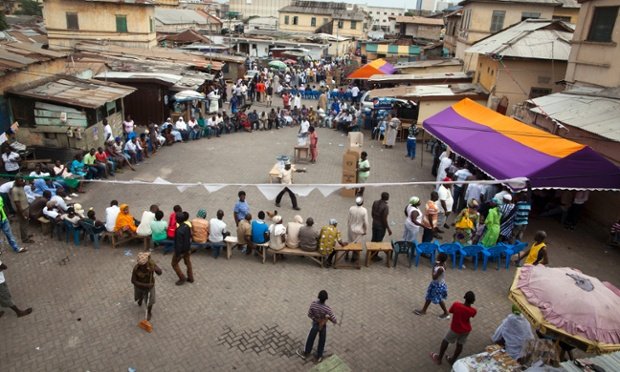 Ghanaians wait their turn to vote at outdoor polling stations in Accra.
