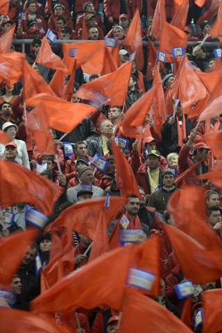 Supporters of the Social Liberal Union coallition (USL) cheer during an election rally in Craiova, Romania. Ruling coalition Social Liberal Union (USL) and opposition coalition ARD are the main competitors for the votes of Romanians who will go to polls on December 9.