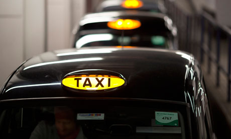 A queue of London taxis.