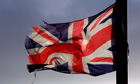 A union flag flies from a lamppost in the Shankill Road area of west Belfast