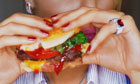 Woman eating a cheeseburger