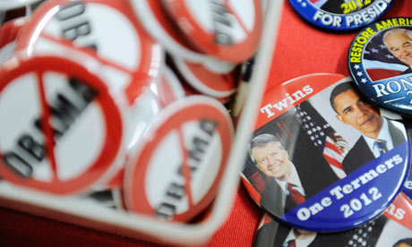 Buttons lampooning Barack Obama are displayed at CPAC.