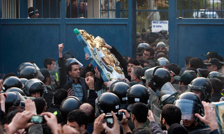 Protestors remove the crest of the British embassy in Tehran