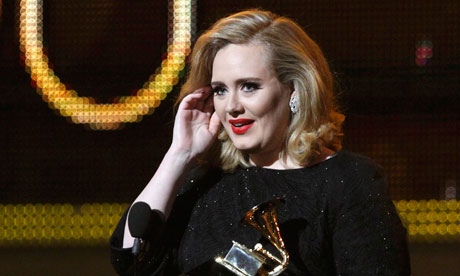 Adele accepts her award for Best Pop Solo Performace at the Grammys