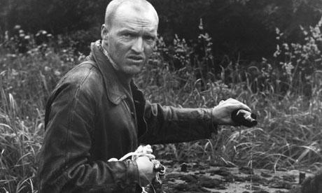 Man in a field, a still from Tarkovsky's film Stalker, 1979