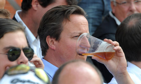 David Cameron enjoying a pint during a Test match in August 2011