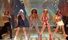 The Spice Girls perform on stage at the Brit Awards ceremony in 1997