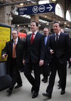 Nick Clegg and David Cameron arrive at Gare du Nord station in Paris on 17 February 2012.