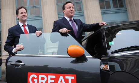 David Cameron and Nick Clegg with a Great Britain-branded Mini at Gare du Nord station in Paris