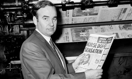 Rupert Murdoch with a copy of the Sun in 1969