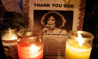 Candles burn at a memorial to Whitney Houston outside New Hope Baptist church in Newark, New Jersey