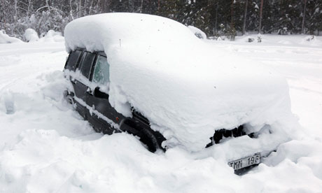 http://static.guim.co.uk/sys-images/Guardian/Pix/pictures/2012/2/19/1329675703328/Man-trapped-in-snowed-in--007.jpg