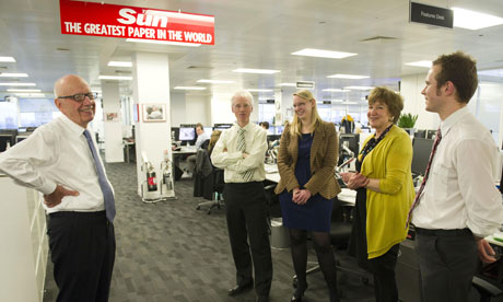 Rupert Murdoch, left, in the newsroom of the Sun on Friday, where he announced the launch of the new Sunday tabloid. Photograph: Arthur Edwards/News Internationa/PA
