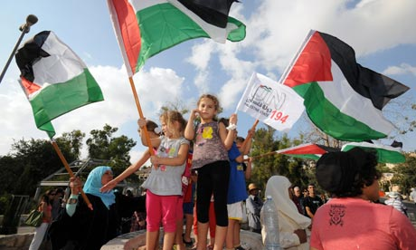 Activists wave Palestinian flags