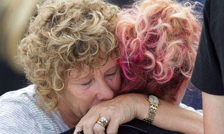 People embrace during the earthquake anniversary remembrance event in Christchurch.