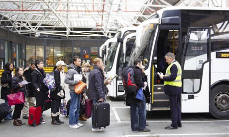 Passengers board a National Express bus at Victoria coach station