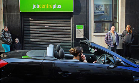 Woman speaks on mobile phone as she drives a sports car
