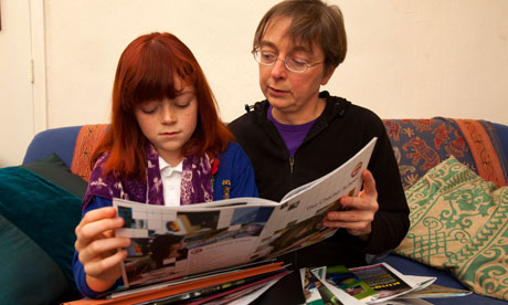 A mother and daughter looking at secondary school prospectuses