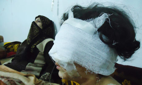 Wounded girl is seen in Baba Amro, Homs