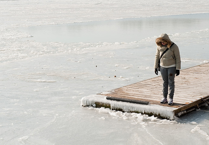 Frozen Venice: A woman looks at the frozen Venice Lagoon