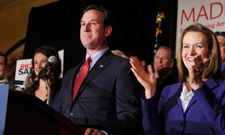 Rick Santorum celebrates in St Charles, Missouri.
