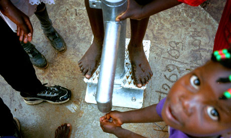 Child at a water pump in Uganda
