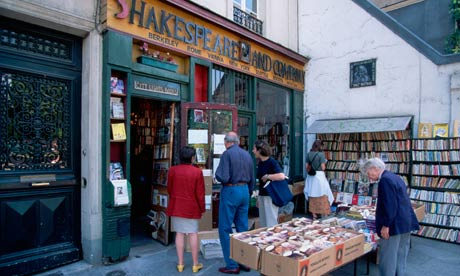 People Looking at Books Outside Bookstore