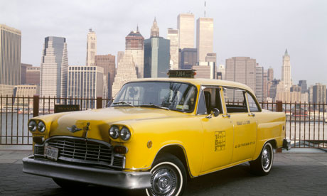 New York taxi and skyline