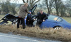 A motorist gets out of a crashed car on the A66 in County Durham amid icy weather conditions
