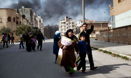 A family escapes from fierce fighting between Free Syrian Army fighters and government troops in Idlib, north Syria. Photograph: Rodrigo Abd/AP