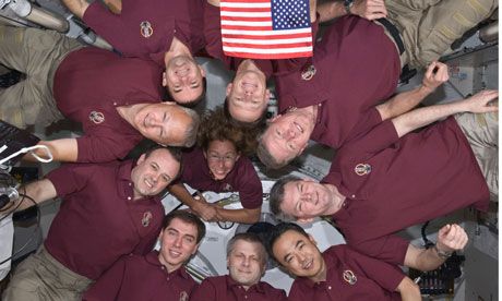 A 'microgravity circle' of astronauts on the International Space Station
