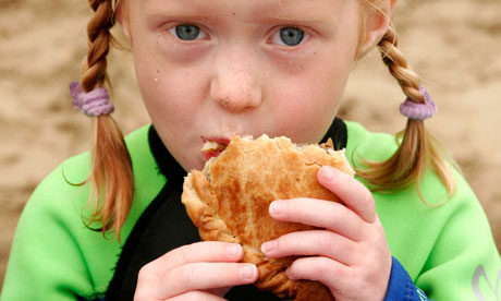 Young girl eating a Traditional Cornish Pasty