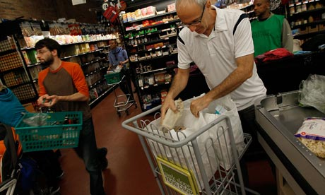 Shoppers bag their groceries at the Park Slope Food Coop in Brooklyn