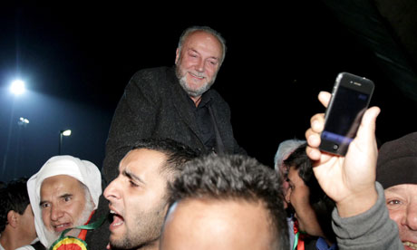 George Galloway celebrates with his supporters after winning the Bradford West by-election