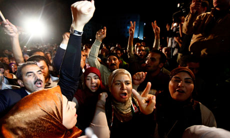 Supporters of the Islamist Ennahda movement celebrate outside Ennahda's headquarters in Tunis
