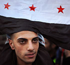 A Syrian migrant attends a rally against President Bashar al-Assad at the Syrian embassy in Sofia