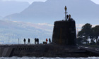 A Vanguard class nuclear submarine, carrying Trident nuclear missiles, leaves Faslane, Scotland.
