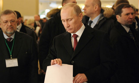 Vladimir Putin casts his vote at a polling station in Moscow on 4 March 2012.