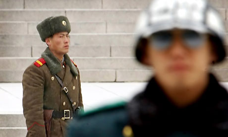 A North Korean soldier and a South Korean soldier on the border